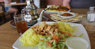 Chicken shawarma platter with a side of zaalook and Moroccan tea.